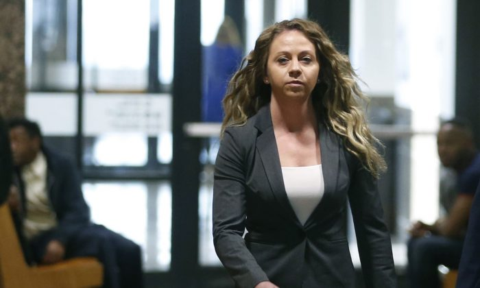 Former Dallas Police officer Amber Guyger walks the hallway on her third court appearance at the Frank Crowley Courts Building in Dallas, on March 18, 2019. (Vernon Bryant/The Dallas Morning News via AP, File)