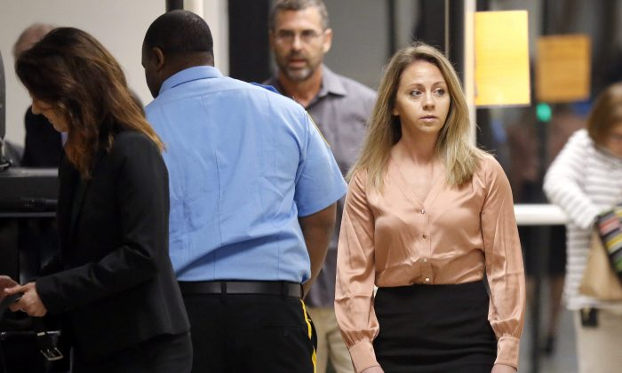 Fired Dallas police Officer Amber Guyger (R) arrives for jury selection in her murder trial at the Frank Crowley Courthouse in downtown Dallas, on Sept. 13, 2019. (Tom Fox/The Dallas Morning News via AP)