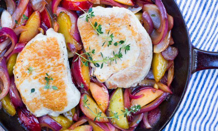 One-skillet pork chops with cooked plums. (Caroline Chambers)