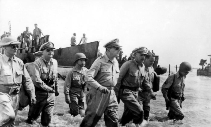 General MacArthur returns to the Philippines. This image, taken by Gaetano Faillace, is re-created in larger-than-life statues at MacArthur Landing Memorial National Park.  National Archives and Records Administration, (Public Domain)