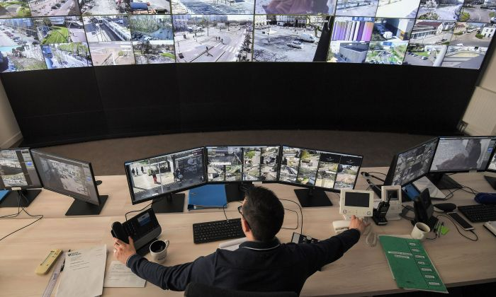 An Urban Supervision Center employee watches screens displaying CCTV (Closed-circuit television) outdoor security cameras of downtown Nantes, France on March 27, 2019. (LOIC VENANCE/AFP/Getty Images)