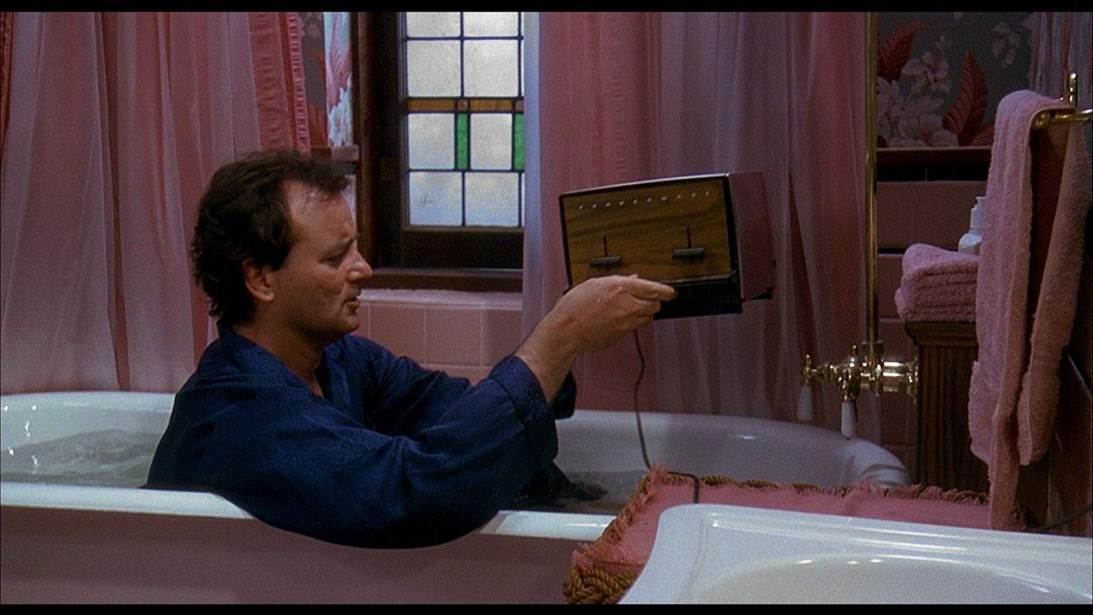 a man, a toaster, a bathtub