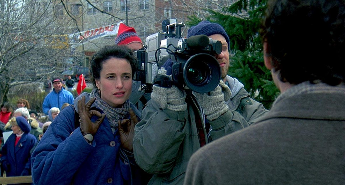 woman in blue jacket with camera man