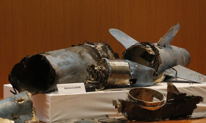 Remains of what was described as a misfired Iranian cruise missile used in an attack this weekend that targeted the heart of Saudi Arabia's oil industry, is displayed during a press conference by Saudi military spokesman Col. Turki al-Malki, in Riyadh, Saudi Arabia, on Sept. 18, 2019. (Amr Nabil/AP Photo)