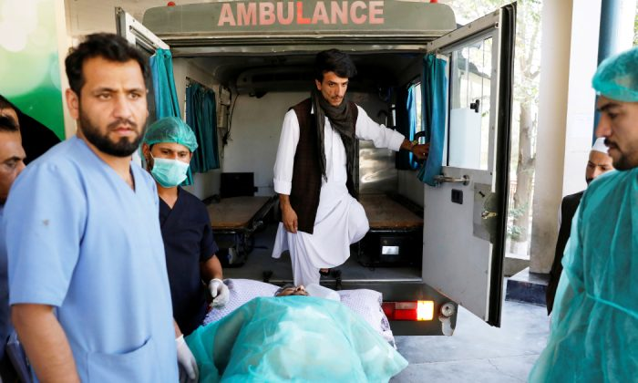 An injured man is transported to an ambulance at a hospital, after a blast in Kabul, Afghanistan Sept. 17, 2019. (Mohammad Ismail/Reuters)