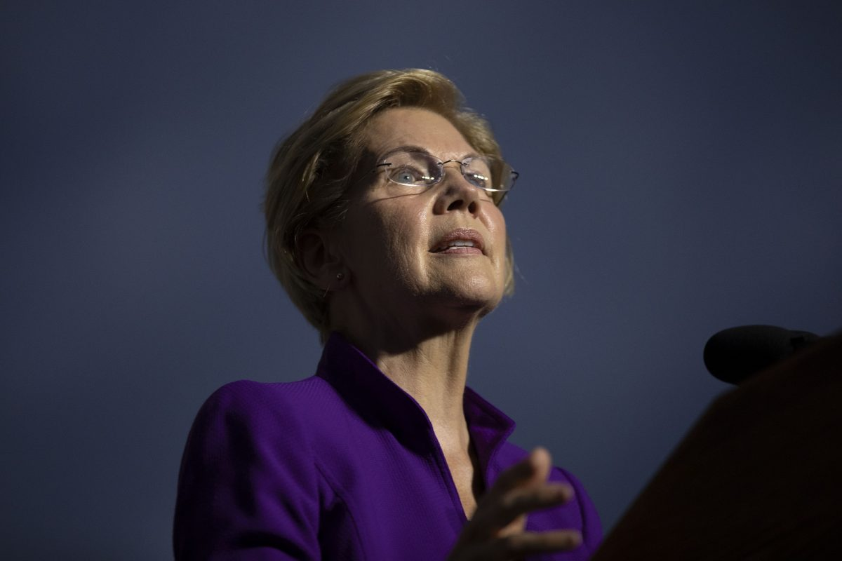 warren campaign fires official