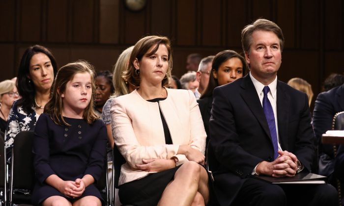 Judge Brett Kavanaugh sits next to his wife Ashley Kavanaugh, and daughter Liza, before the Senate Judiciary Committee during the first day of his confirmation hearing  to serve as Associate Justice on the U.S. Supreme Court at the Capitol in Washington on Sept. 4, 2018. (Samira Bouaou/The Epoch Times)