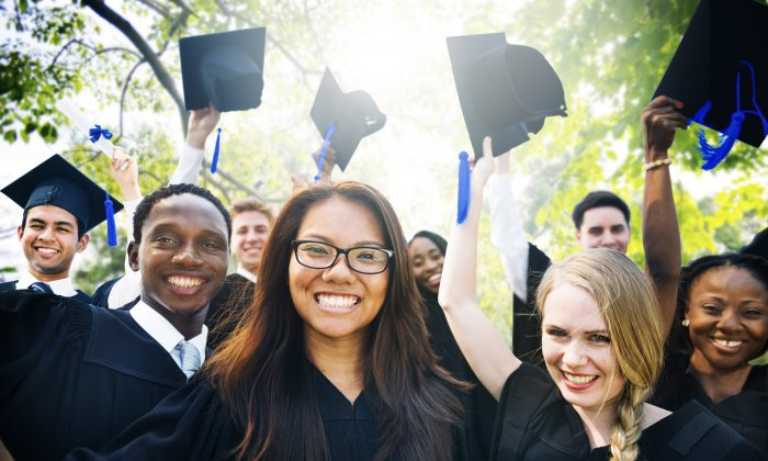 Stock image of college students at graduation ceremony. (Shutterstock)