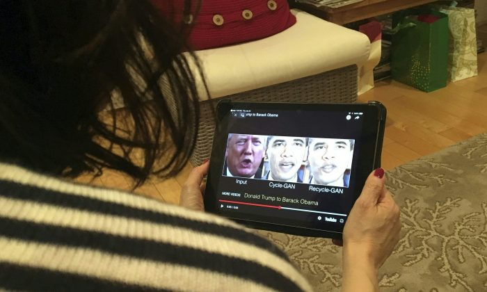 A woman in Washington, DC, views a manipulated video on Jan. 24, 2019. (Rob Lever/AFP/Getty Images)