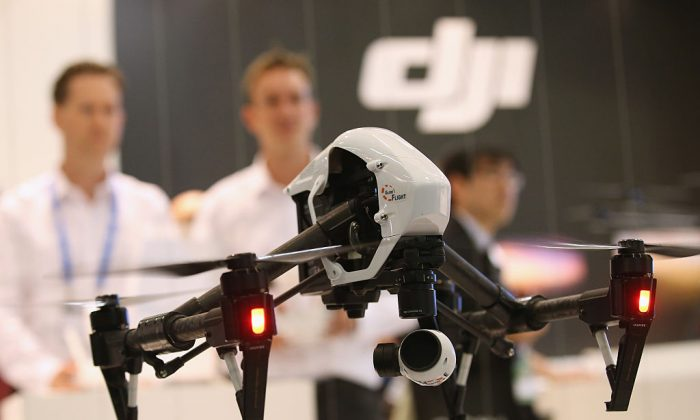 DJI Inspire 1 quadcopter drone flies at the DJI stand at the 2015 IFA consumer electronics and appliances trade fair in Berlin, Germany, on Sept. 4, 2015. (Sean Gallup/Getty Images)