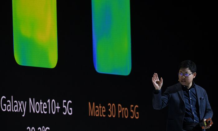 "Richard Yu Chengdong, head of Huawei's consumer business Group, at a presentation to reveal Huawei's latest smartphones ""Mate 30"" and ""Mate 30 Pro"" in Munich, Germany, on Sept. 19, 2019. (CHRISTOF STACHE/AFP/Getty Images)"