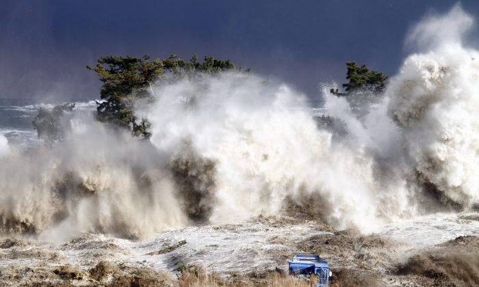 Tsunami waves hitting the coast of Minamisoma in Fukushima prefecture, Japan, on March 11, 2011. (Sadatsugu Tomizawa/AFP/Getty Images)
