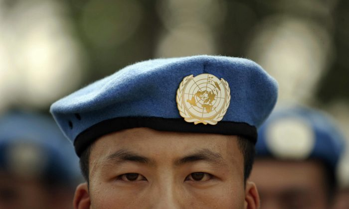 People's Liberation Army (PLA) soldiers deployed for United Nations (UN) peace keeping missions line up at their base in China's central Henan province before being sent to Africa on Sept. 15, 2007. (PETER PARKS/AFP/Getty Images)