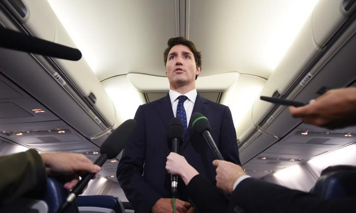 "Liberal leader Justin Trudeau responds to a question during a scrum on his campaign plane in Halifax, N.S., on Sept. 18, 2019 after making a statement in regards to a photo coming to light of himself from 2001 wearing ""brownface."" (The Canadian Press/Sean Kilpatrick)"