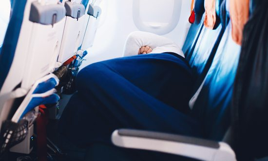Photo of Man Standing for 6 Hours in Airplane Aisle to Let Wife Sleep Sparks Debate