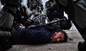 Amnesty International Accuses Hong Kong Police of 'Brutal Beatings,' Torture