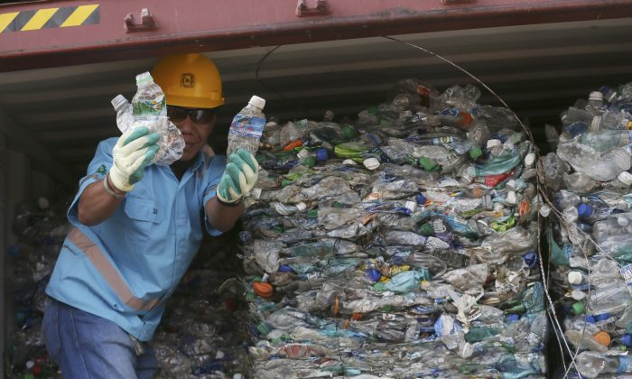 A worker shows plastic waste at Tanjung Priok port in Jakarta, Indonesia on Sept. 18, 2019. (Achmad Ibrahim/AP)