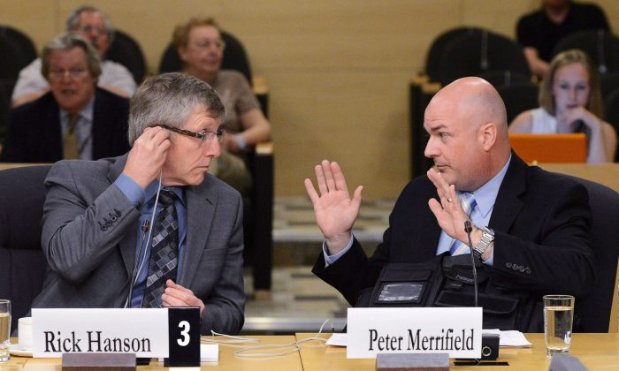 Rick Hanson, chief of the Calgary Police Service, and Peter Merrifield, president of the Mounted Police Association of Ontario, appear at Senate national security committee to discuss harassment in the RCMP on May 27, 2013. The Supreme Court of Canada will not hear Merrifield's argument that he should be compensated for alleged harassment by superiors. (THE CANADIAN PRESS/Sean Kilpatrick)