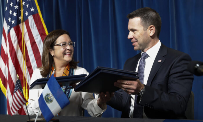 Acting Secretary of Homeland Security Kevin K. McAleenan with Alexandra Hill, Minister of Foreign Affairs for El Salvador, after signing an agreement during news conference at the US Customs and Border Protection Headquarters in Washington, Friday, Sept. 20, 2019. McAleenan and Hill announced that the US has reached an accord aimed at making El Salvador a haven for migrants seeking asylum. (AP Photo/Pablo Martinez Monsivais)