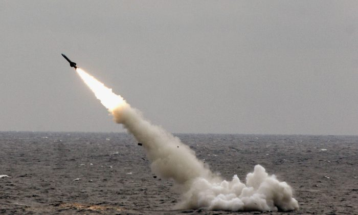 "A Chinese submarine launches a missile in an offshore blockade exercise during the third phase of the Sino-Russian ""Peace Mission 2005"" joint military exercise, held Aug. 23, 2005 near China's Shandong Peninsula. (China Photos/Getty Images)"