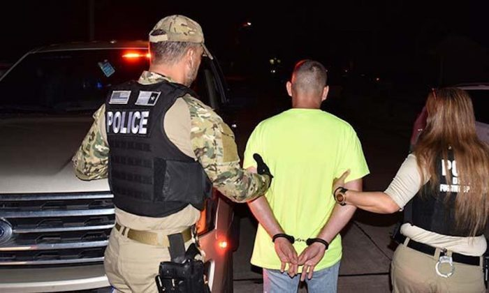 ICE officers take illegal alien Leopoldo Serrano Vargas into custody on Sept. 11, 2019. (ICE)
