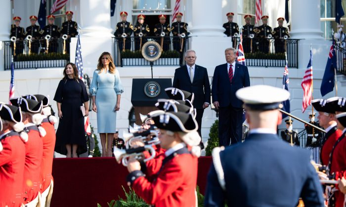 U.S. President Donald Trump and First Lady Melania Trump stand at attention with Australian Prime Minister Scott Morrison (2R) and his wife Jenny Morrison (L) during an Official Visit by the Australian PM at the White House in Washington, DC on Sept. 20, 2019. (Photo by SAUL LOEB/AFP/Getty Images)