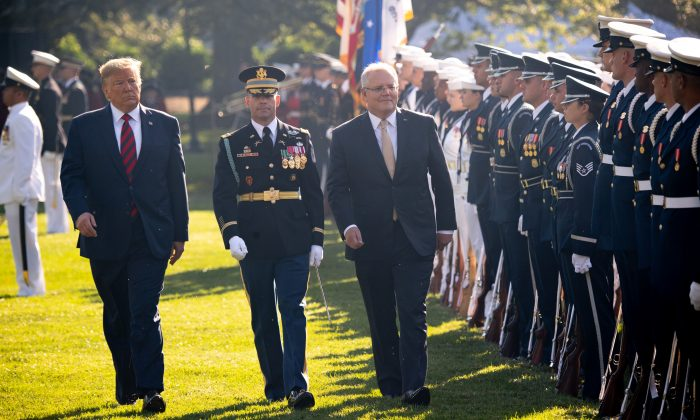 U.S. President Donald Trump (L) and Australian Prime Minister Scott Morrison (R) perform an inspection of the troops during an Official Visit by the Australian PM at the White House in Washington, DC on Sept. 20, 2019. (SAUL LOEB/AFP/Getty Images)