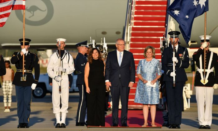 Australia's Prime Minister Scott Morrison and wife Jenny arrive for a state visit, at Andrews Airforce Base in Washington, United States, on Sept. 19, 2019. (AAP Image/Mick Tsikas)