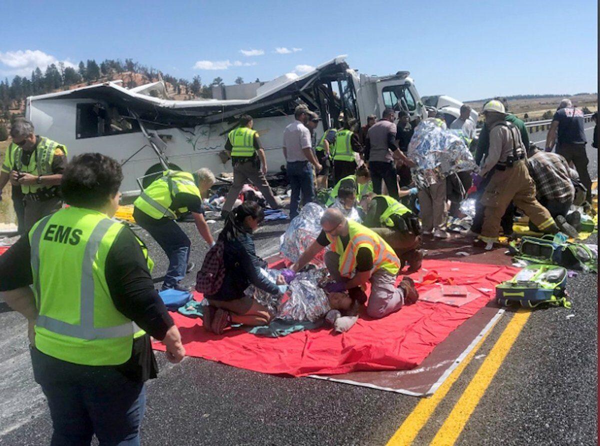 tour bus crash officials tending