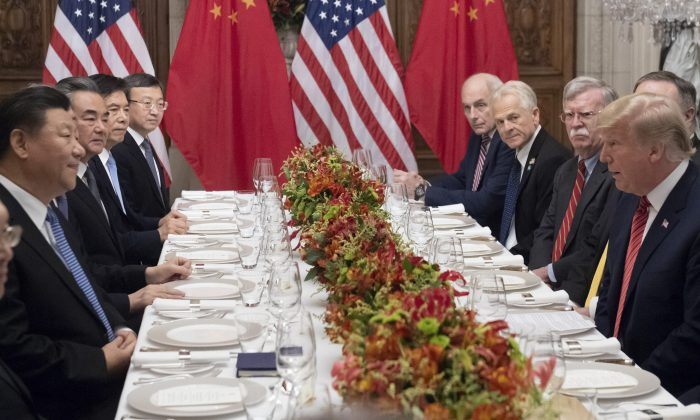 U.S. President Donald Trump (R) and China's President Xi Jinping (L) along with members of their delegations, hold a dinner meeting at the end of the G20 Leaders' Summit in Buenos Aires, on December 01, 2018. - US President Donald Trump and his Chinese counterpart Xi Jinping had the future of their trade dispute -- and broader rivalry between the world's two top economies -- on the menu at a high-stakes dinner Saturday. (Saul Loeb/AFP/Getty Images)