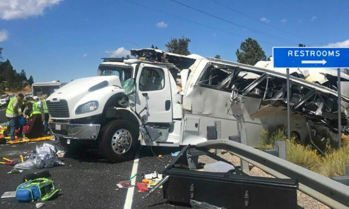This photo released by the Garfield County Sheriff's Office shows a tour bus that was carrying Chinese-speaking tourists after it crashed near Bryce Canyon National Park in southern Utah, killing at least four people and critically injuring up to 15 others, on Sept. 20, 2019. (Sheriff Danny Perkins/Garfield County Sheriff's Office via AP)