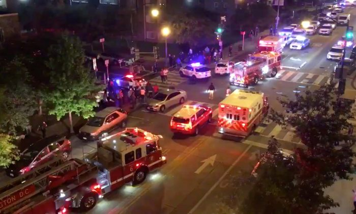 Rescue vehicles are seen following a shooting in Washington, D.C., U.S. September 19, 2019, in this picture obtained from social media. (Chris G Collison/via Reuters)