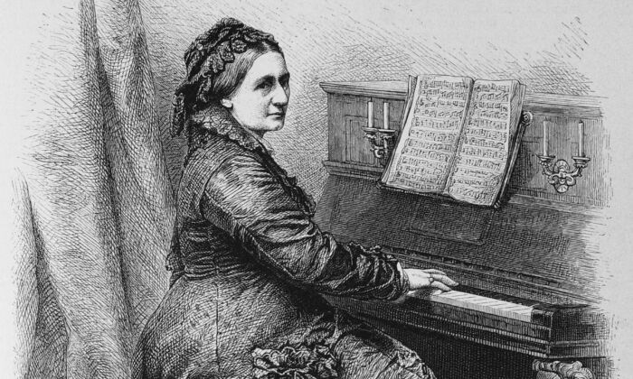 Clara Schumann had an exceptional 60-year career as a pianist. Here she's illustrated at the piano in The Garden Arbor journal, 1888. (Public Domain)