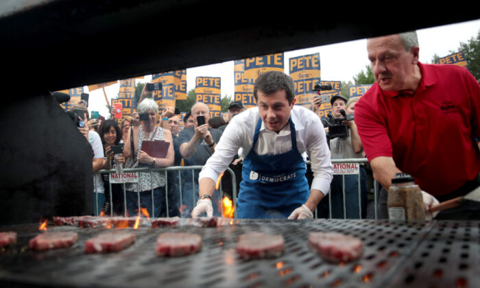 Democratic presidential candidate and South Bend, Indiana mayor Pete Buttigieg works the grill at the Polk County Democrats' Steak Fry in Des Moines, Iowa, on Sept. 21, 2019. (Scott Olson/Getty Images)