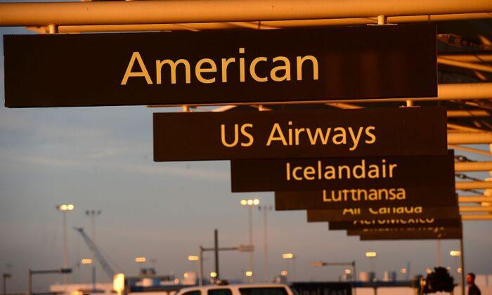 American Airlines sign at Denver International Airport in Denver, Colo., Dec. 9, 2013. (Emmanuel  Dunand/AFP/Getty Images)