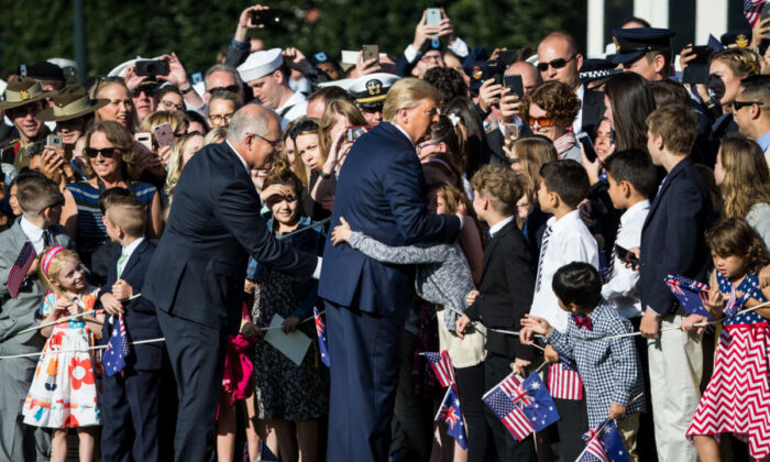 President Donald Trump and Australian Prime Minister Scott Morrison greet members of the audience during an official visit ceremony at the South Lawn of the White House, Washington, on Sep. 20, 2019. (Zach Gibson/Getty Images)
