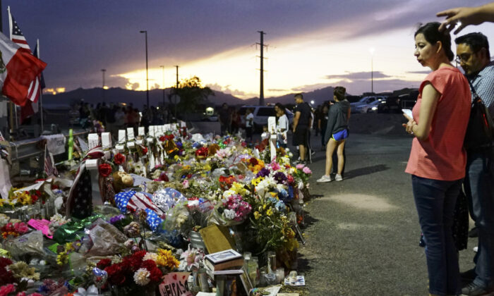 People gather at a makeshift memorial honoring victims outside Walmart Aug. 15, 2019 in El Paso, Texas. (Sandy Huffaker/Getty Images)