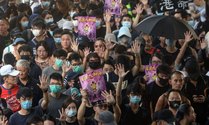 Demonstrators hold up their hands to symbolise the five demands that protesters are asking for, as they take part in a pro-democracy rally in Hong Kong's Tuen Mun district on Sept. 21, 2019. (Philip Fong/AFP/Getty Images)