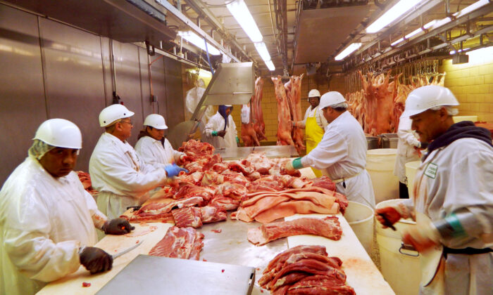 Workers cut pork at a slaughterhouse in Chicago, Illinois July 18, 2015. (Reuters/Karl Plume/File Photo)