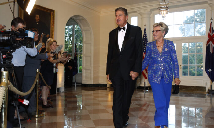 Sen. Joe Manchin, D-W.Va., left, and wife Gayle Conelly Manchin arrive for a State Dinner with Australian Prime Minister Scott Morrison and President Donald Trump at the White House, in Washington on Sept. 20, 2019. (AP Photo/Patrick Semansky)