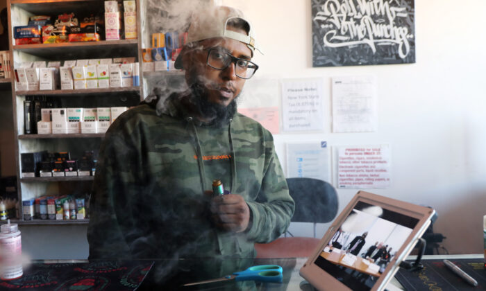 Andy Ramkumar, who works at Gotham Vape in Queens, vapes at the store in New York City on Sept. 17, 2019. (Spencer Platt/Getty Images)