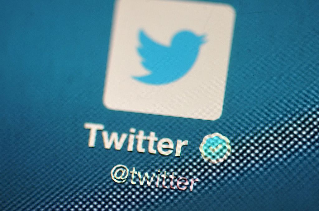 the Twitter logo is displayed on a mobile device in London, England.