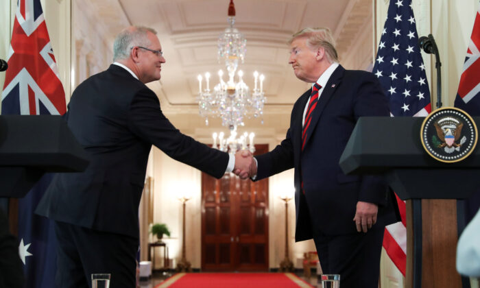 Australia's Prime Minister Scott Morrison shakes hands with U.S. President Donald Trump at the conclusion of a joint news conference in the East Room of the White House in Washington, U.S., on Sept. 20, 2019. (REUTERS/Jonathan Ernst)
