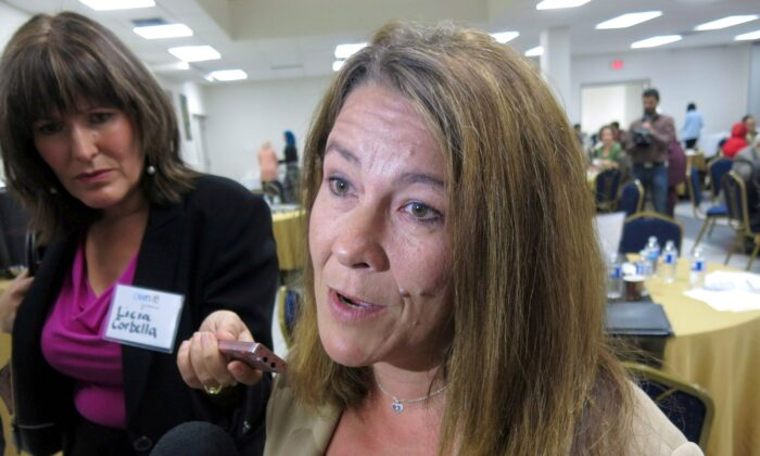 Chris Boudreau, whose son converted to Islam and died fighting in Syria, speaks to reporters on Sept. 11, 2014, at a conference on how to prevent the radicalization of Muslim youth. She believes a Calgary program that links at-risk young people with police officers and social workers to steer them away from dangerous ideologies should be mandatory. (THE CANADIAN PRESS/Bill Graveland)