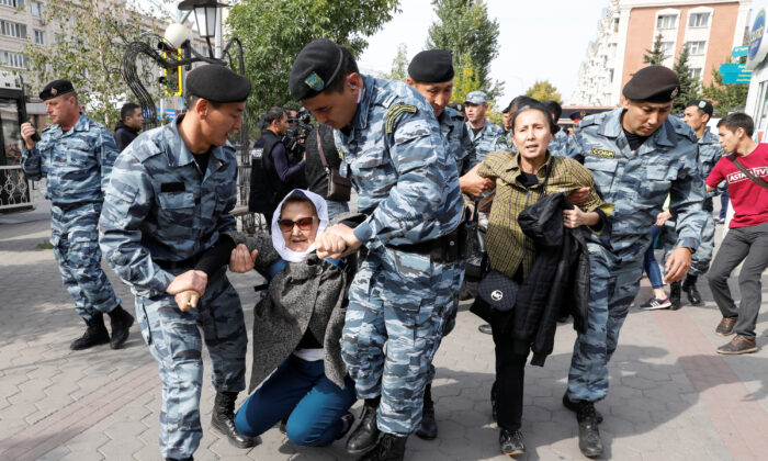 Kazakh law enforcement officers detain women during a rally held by opposition supporters in Nur-Sultan, Kazakhstan on Sept. 21, 2019. (Mukhtar Kholdorbekov/Reuters)