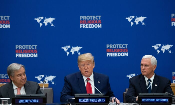 US President Donald Trump (C) speaks alongside US Vice President Mike Pence (R) and UN Secretary General Antonio Guterres (L) at a United Nations event on Religious Freedom at UN Headquarters in New York, Sept. 23, 2019. (SAUL LOEB/AFP/Getty Images)