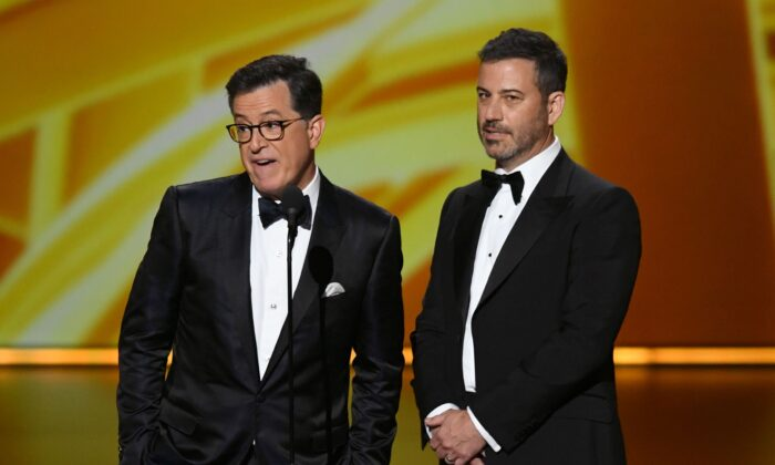 Stephen Colbert and Jimmy Kimmel speak onstage during the 71st Emmy Awards at Microsoft Theater in Los Angeles, California on Sept. 22, 2019. (Photo by Kevin Winter/Getty Images)