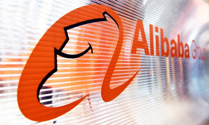 A logo of the Chinese multinational e-commerce, retail, internet, and technology conglomerate, Alibaba group, is pictured on a window of a stand during the Vivatec trade fair (Viva Technology) in Paris, France, on May 24, 2018. (Alain Jocard/AFP/Getty Images)