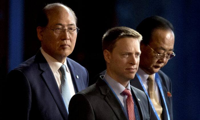 Matt Pottinger (C), Special Assistant to U.S. President Donald Trump and National Security Council (NSC) Senior Director for East Asia, and Kim Yong Jae (R), North Korea's minister of external economic relations, arrive for the opening ceremony of the Belt and Road Forum at the China National Convention Center (CNCC) in Beijing, on May 14, 2017. (AP Photo/Mark Schiefelbein)