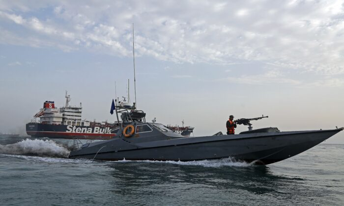 A picture taken on July 21, 2019, shows Iranian Revolutionary Guards patrolling around the British-flagged tanker Stena Impero off the Iranian port city of Bandar Abbas. (HASAN SHIRVANI/AFP/Getty Images)